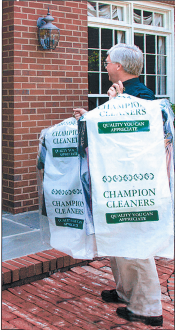 Champion Cleaners Delivering a Dry Cleaning Order