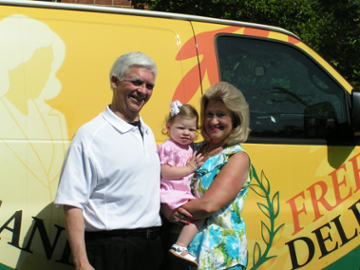 Image of David Sherry and Granddaughter Callie in front of Champion Cleaners Delivery Van.png